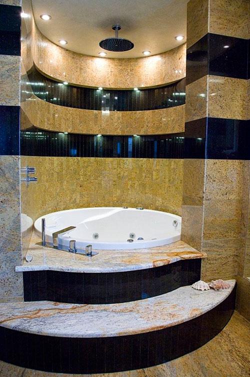 Фото. Отделка ванной гранитом – очень прочная и декоративная