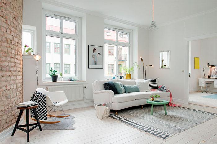 Для гостиной в скандинавском стиле также подойдут светлые стены