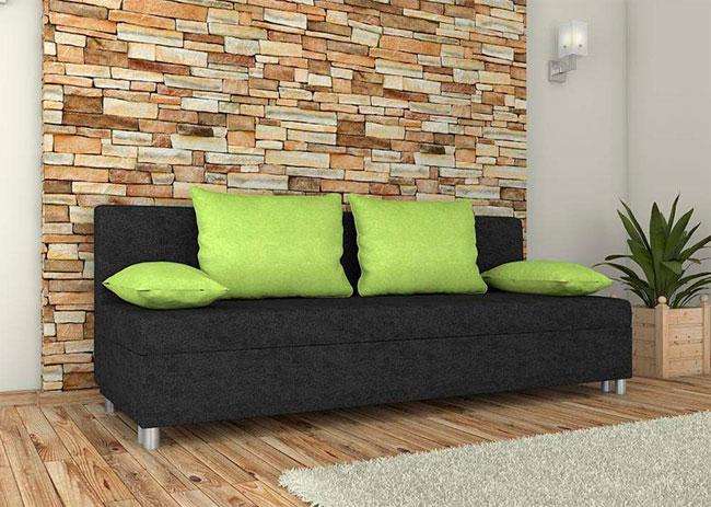 Черный диван напротив стены из камня