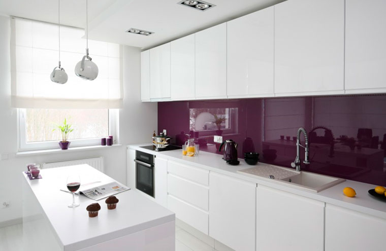 The wall above the tabletop is made of glossy glass of bright purple color.