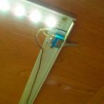 Профиль с LED тесьмой монтируется к шкафу с помощью саморезов или приклеивается