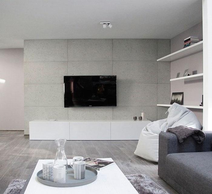 Модная отделка стен в гостиной бетоном
