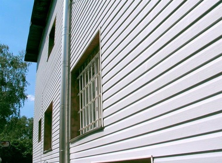 Наружная отделка дома панелями – фото
