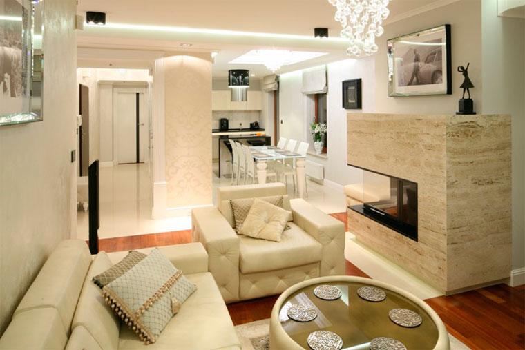 Дизайн гостиной в доме с камином
