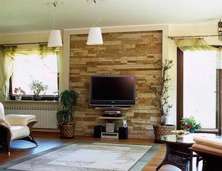 Телевизор на стене из кирпича, камня или бетона