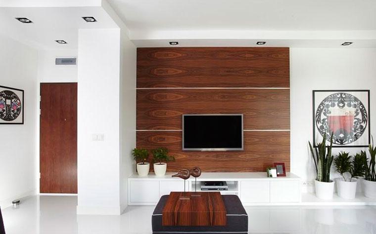 Телевизор на стене в интерьере гостиной – фото