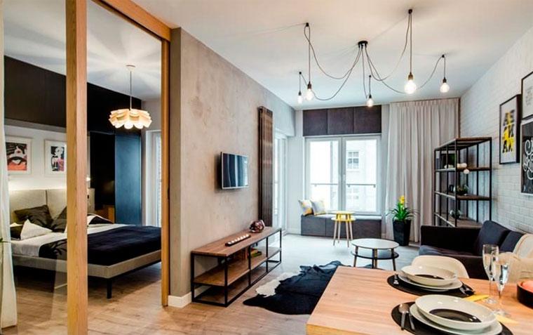 Стиль лофт в интерьере – фото маленькая комната со стильной лампой