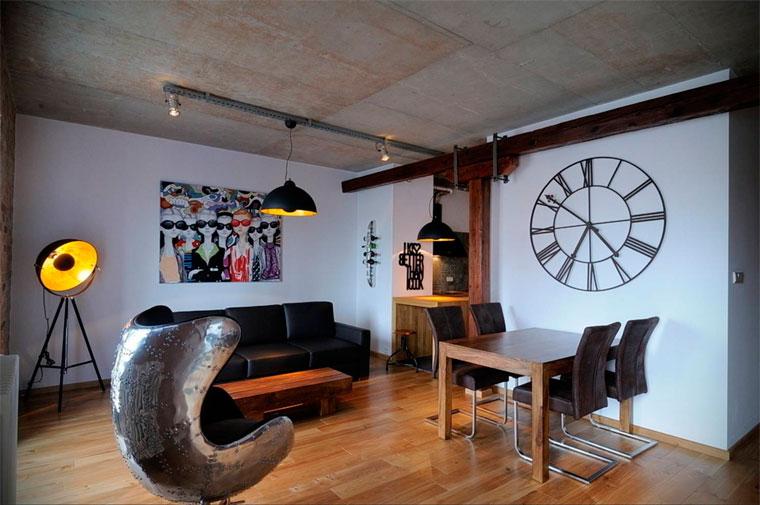 Современный интерьер гостиной в светлых тонах серого